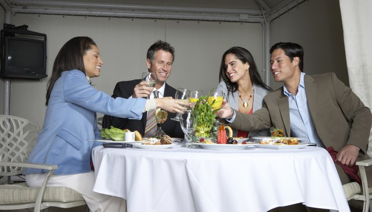 Businesspeople toasting at restaurant table