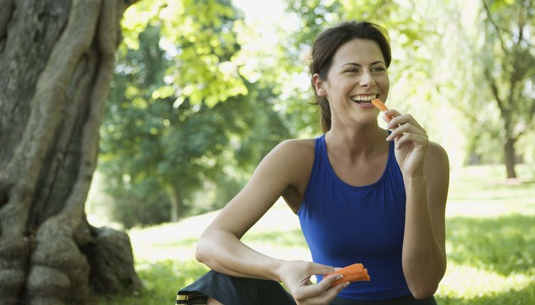 Smiling woman with carrot