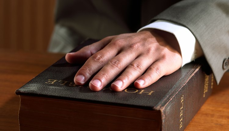Hand on bible, swearing in