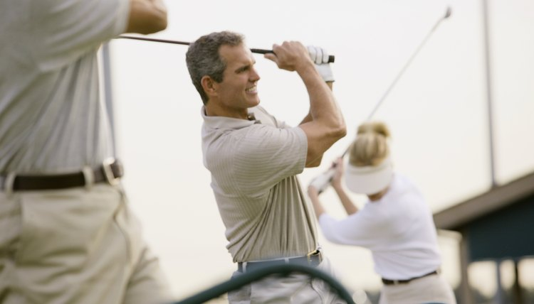 Barriers between hitting areas protect golfers but  are not required by law.