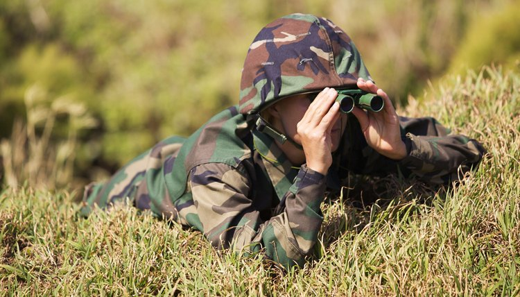 Soldier looking through binoculars