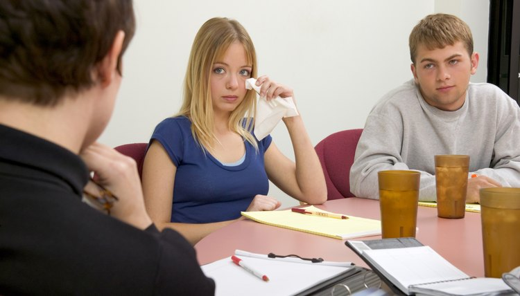 Social workers help families attempt to work out their problems.