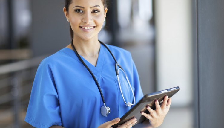 female medical intern with tablet computer