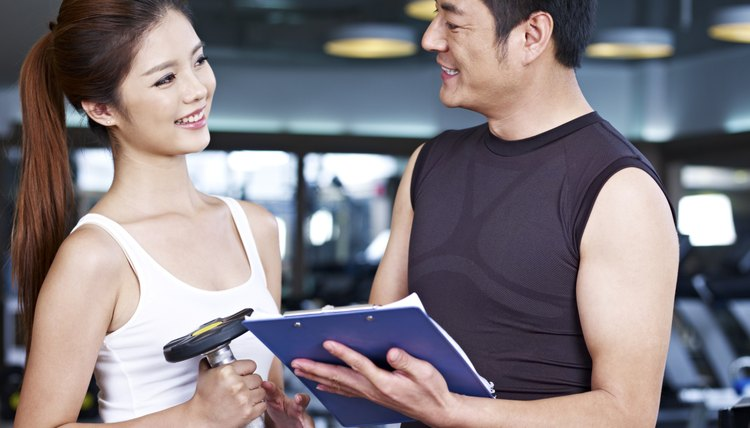 young man and woman talking in gym