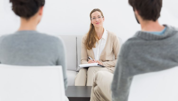Female financial adviser in meeting with young couple