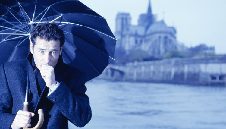 Paris, France, Man with umbrella by river