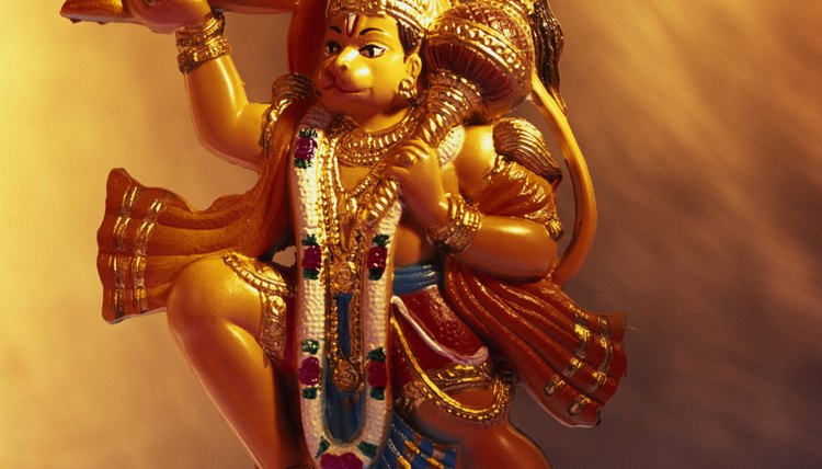 Vishnu's four hands hold objects representing the flow of life and the universe.
