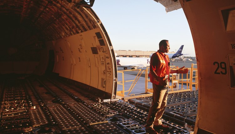 Airport worker looking out of aeroplane from loading bay