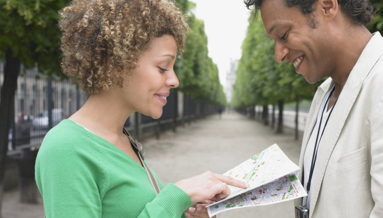 Young couple looking at map together.
