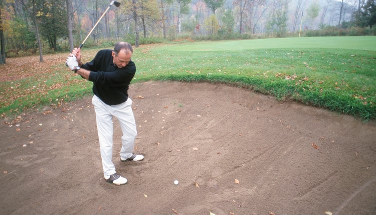 Open your stance in a greenside bunker.
