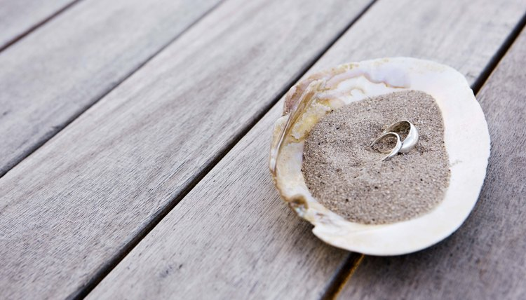Couples may choose to pour the sand from a shell.