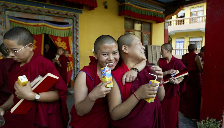 Buddhist nuns take a break after a prayer session.