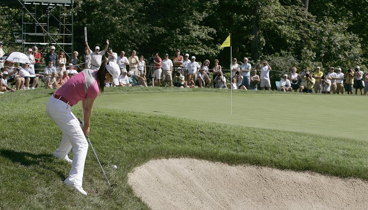 Unlike Michelle Wie, weekend players frequently straighten up when the ball is below their feet and top the shot.