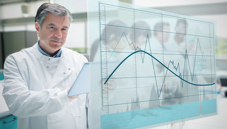 Confident scientist working with tablet and futuristic interface showing graph