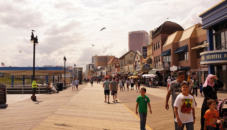 Tourists walk along the boardwalk in Atlantic City, New Jersey.