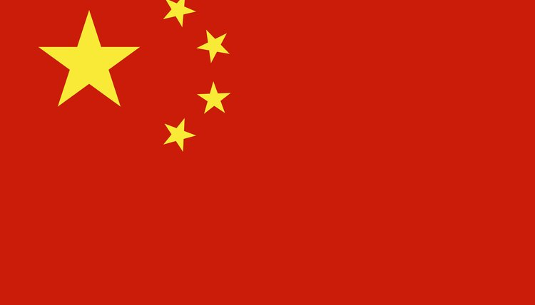A closeup of China's national flag which represents a country that practices and upholds the laws of Communism