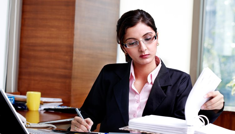 Businesswoman at desk writing