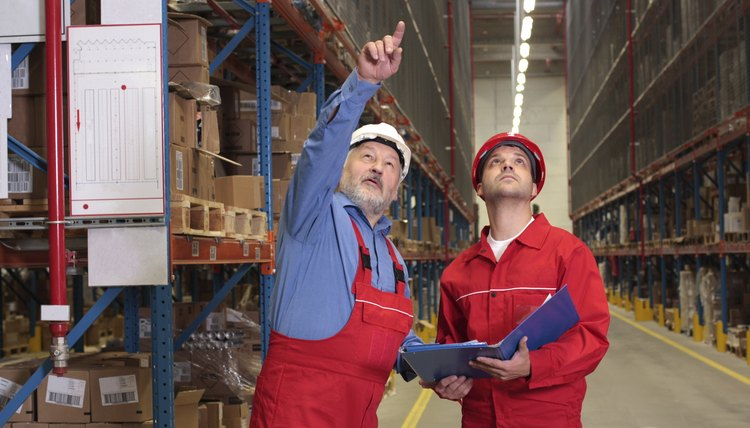 two inspectors in warehouse
