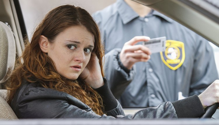 Woman looks away after being pulled over, horizontal