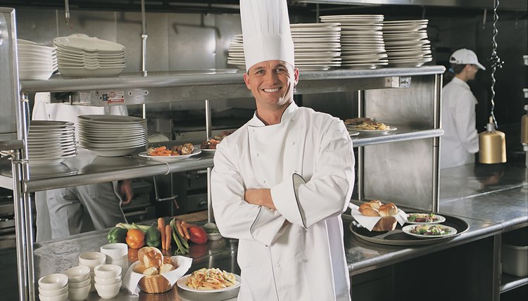 Chef posing in kitchen of restaurant