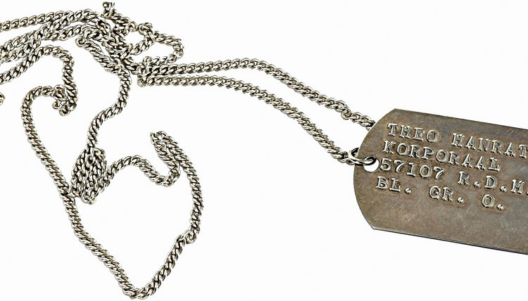 Dog tags list a soldier's name, social security number and blood type.