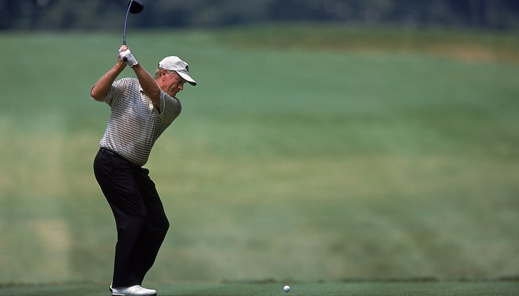 Jack Nicklaus flexes his left knee during his backswing, forcing his left foot and ankle to turn along with the knee.