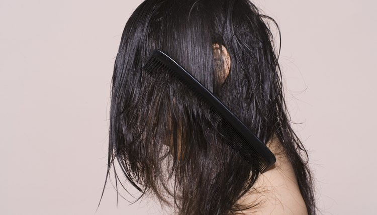 Remove tangles from hair before it becomes difficult to work with.