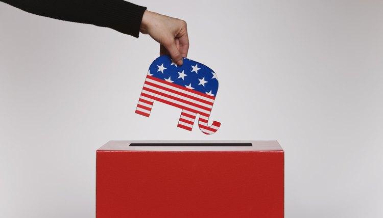 Individual placing politically symbolic symbol into voting box