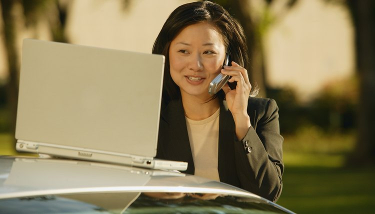 Businesswoman talks on cell phone