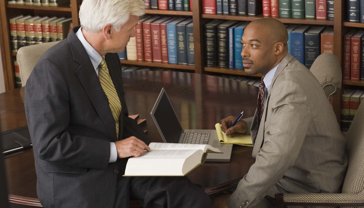 Lawyers researching in a library