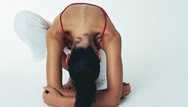 Woman kneeling in a yoga position