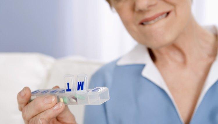Worried woman with pill dispenser