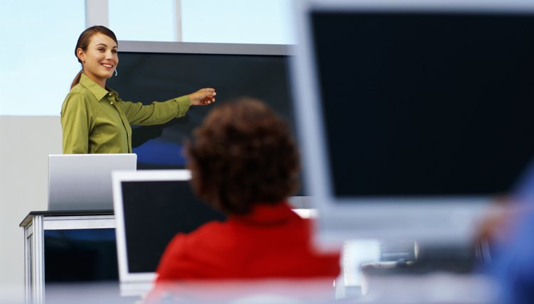 businesswoman pointing to a projection screen at a seminar