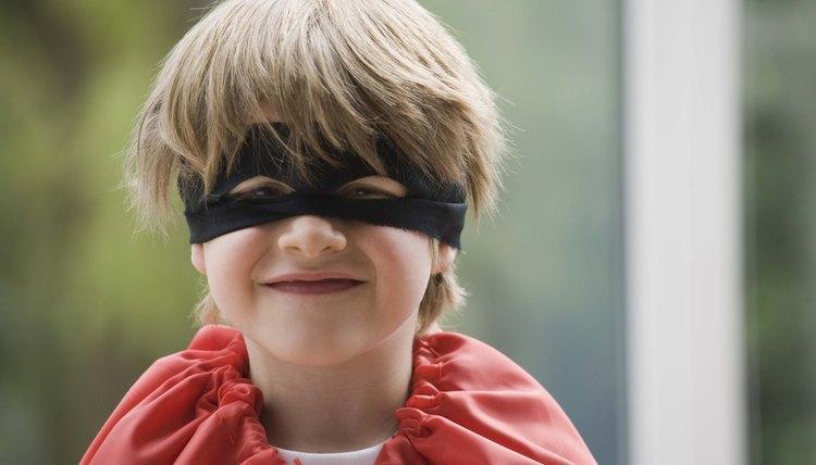 Create a fabric mask to match his custom superhero cape.