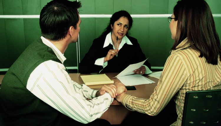 Businesswoman talking to couple
