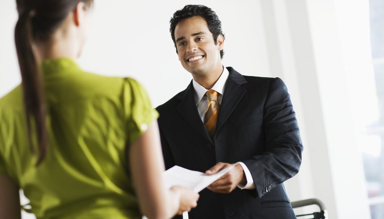 Businessman giving papers to client