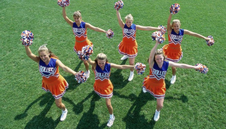 High angle view of a group of cheerleaders cheering in a field