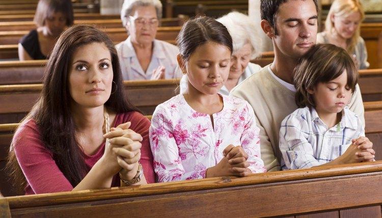 Family praying in church.