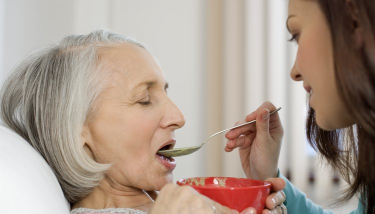 Woman feeding patient