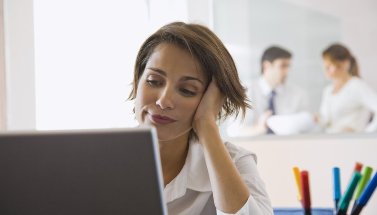 Bored businesswoman using laptop computer