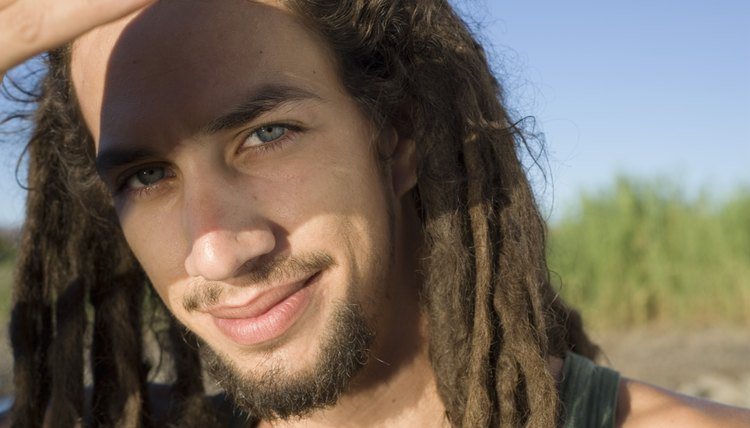 Palm rolling helps new dreads to keep their volume.