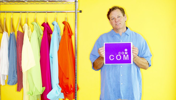 Man holding dot com sign and clothes rack