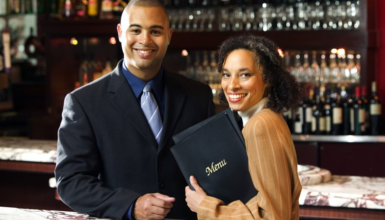 Host and hostess in restaurant bar