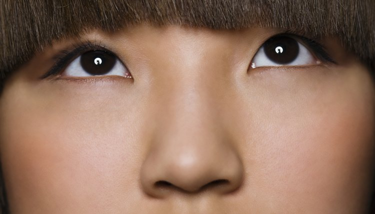 Front-of-face bangs make an impact and highlight your facial features.