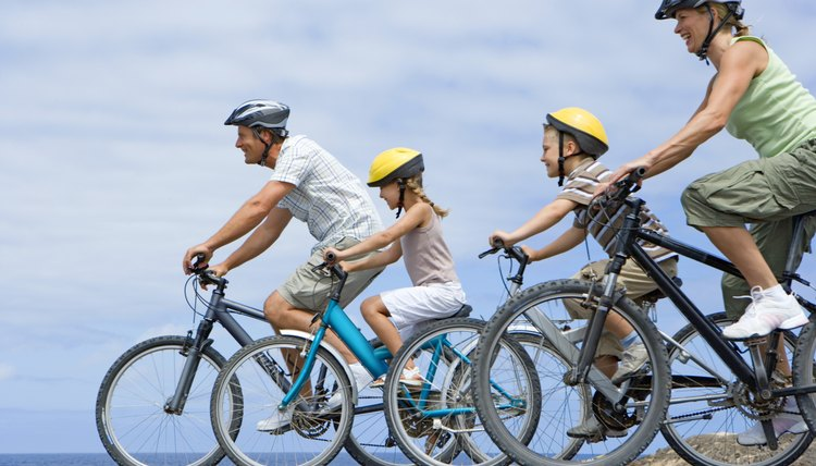 """Bicycling together down the road"" is an example of a gerund phrase."