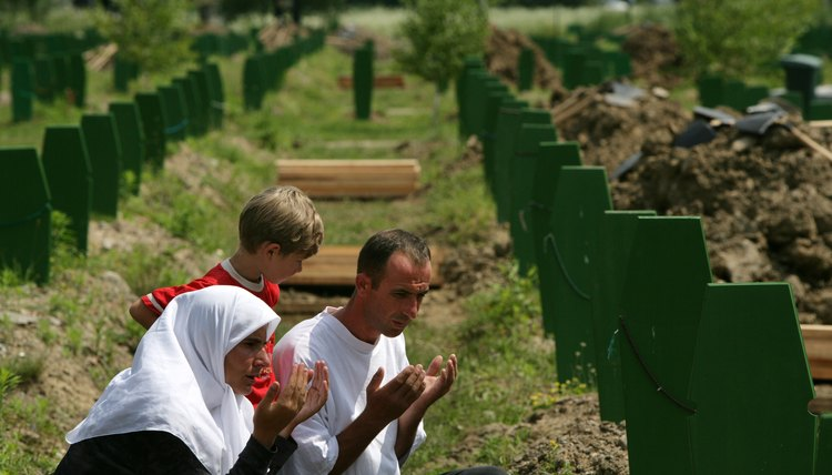 Bosnians remember victims at a mass burial site.