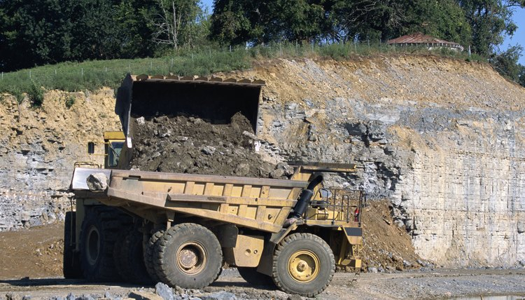 Dump truck at road building site