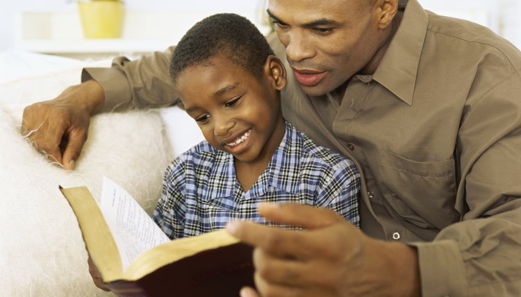 Father and son reading the bible.