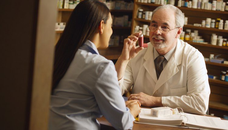 Pharmacist giving patient medical advice