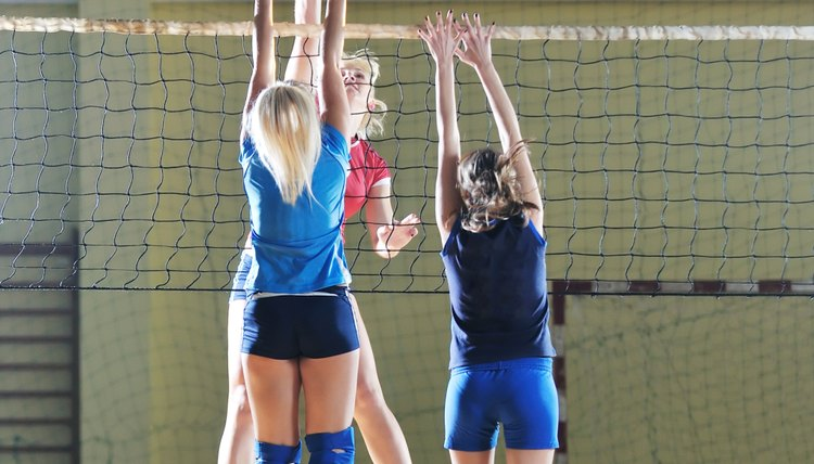 Girls playing volleyball.